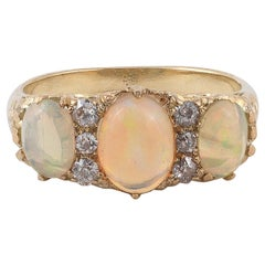 Opal Three-Stone and Old-Cut Diamond Ring