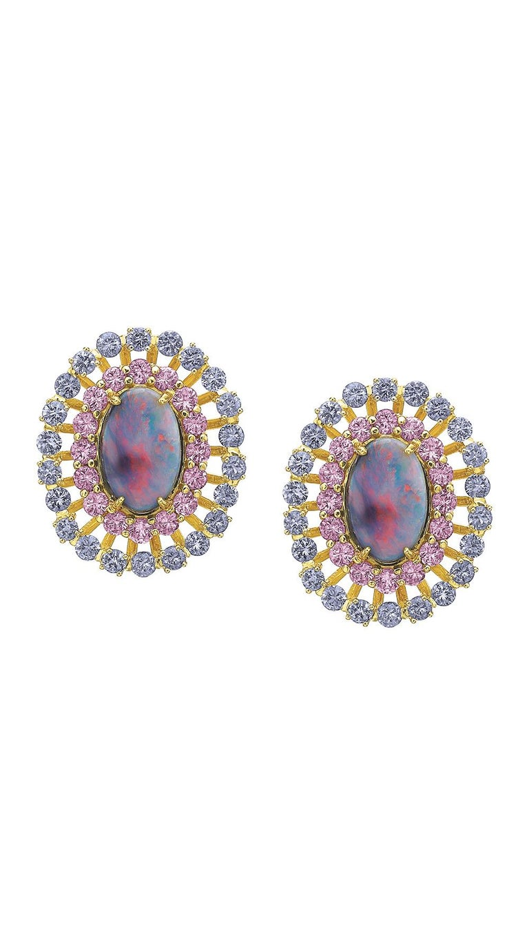 These Spectacular Australian Lightning Ridge Day to Night Earrings are a stunning combination of colors to light up the face (and the room)! 5.1 carats of Lightning Ridge Oval Black Opals and 21.05 carats of Blue Jelly Opals from the same region.