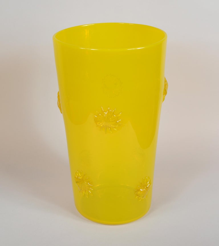 Opalescent yellow glass vase from the Empoli region of Italy. This has applied starbursts around the vase.