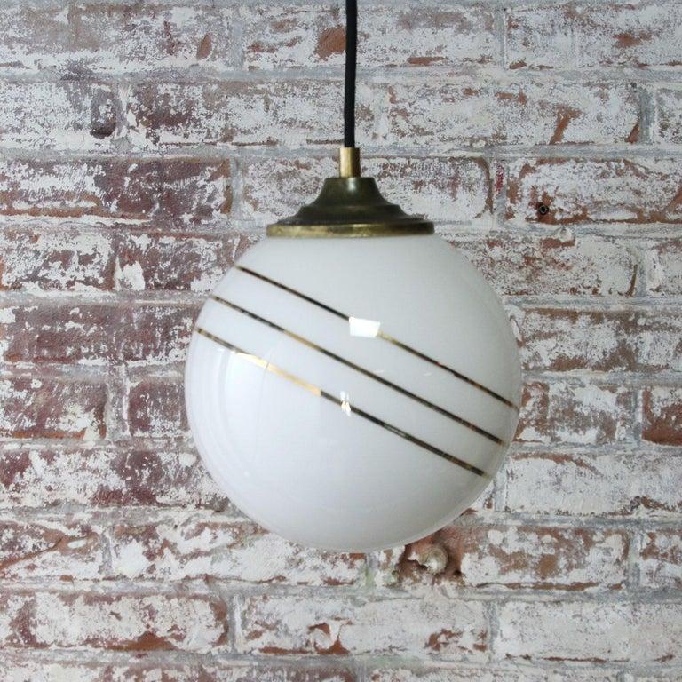 20th Century Opaline Glass Gold Striped Vintage European Globe Brass Top Pendant Lights For Sale