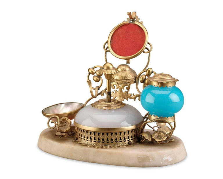 This superb opaline glass perfume set is wonderfully equipped with a bell push and inkwell set in doré bronze and mounted on a marble base. Excellent condition, circa 1860.