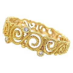 Open Scrollwork Band in 18 Karat Yellow Gold with Diamond Accents