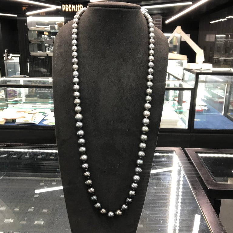 A lovely gorgeous opera ombre necklace featuring 75 Tahitian pearls measuring 9.2-13.5 mm in a white gold diamond ball clasp.  Pearl quality: AAA Pearl Luster: AAA Excellent Nacre : Very Thick  Strand can be made to order, shortened or longer. Clasp