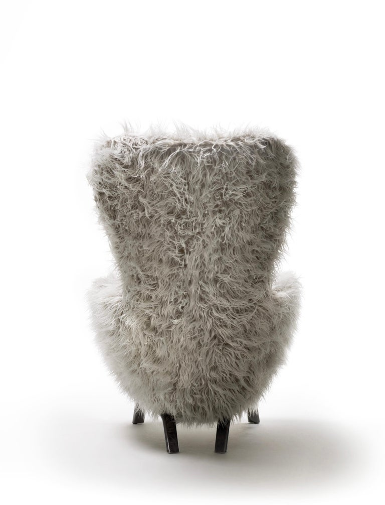 A cozy and comfortable bucket seat, a reassuring form with absolutely contemporary details; these are the main features of the Guelfo collection designed by Lapo Ciatti.  Guelfo wingback chair and pouf were launched in 2015 with the aim to give a