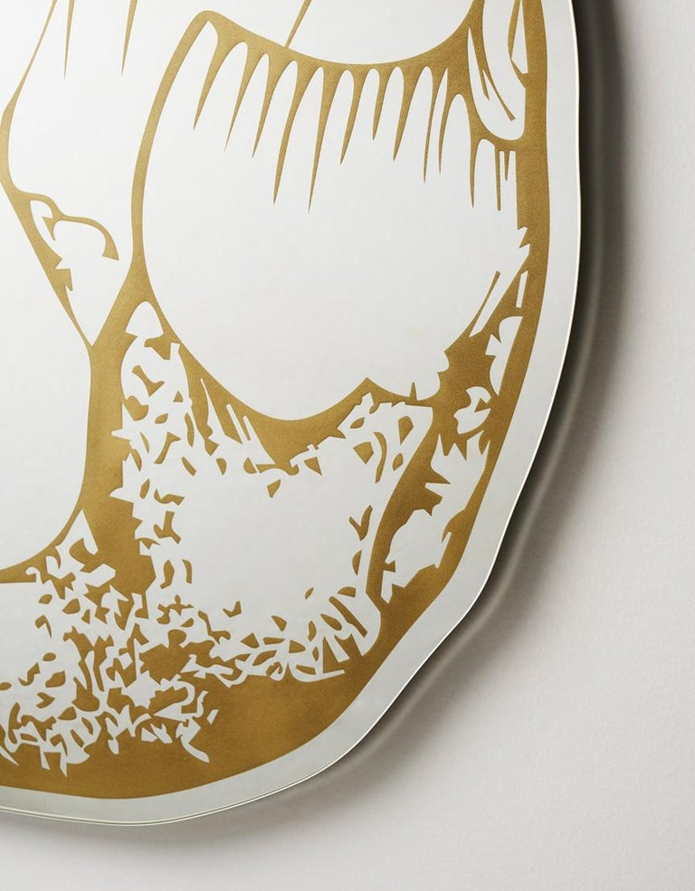 Selce is a shaped mirror designed by Marcantonio, with golden serigraphy decorations that re-interpret the first crafted stones. It is a tribute to the know-how of mankind: our ability to learn, absorbing the techniques used by our peers, and the