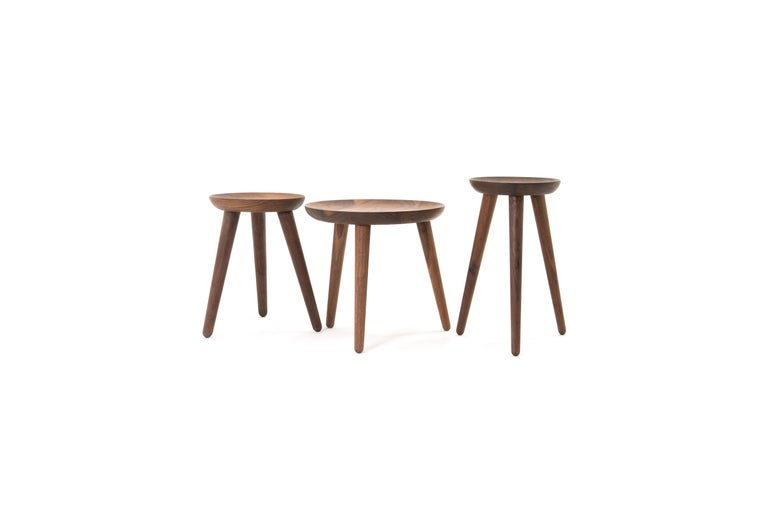The opium is a set of side tables, also available individually, made from turned solid walnut and angled tenon joints. The wood top is inspired by the shape of the opium poppy and fits instantly in modern and classical homes.   This handcrafted
