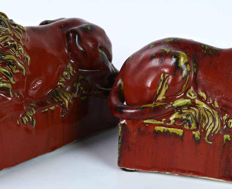 Opposing Pair of 20th Century Oxblood and Celadon Glazed Ceramic Resting Lions For Sale 9