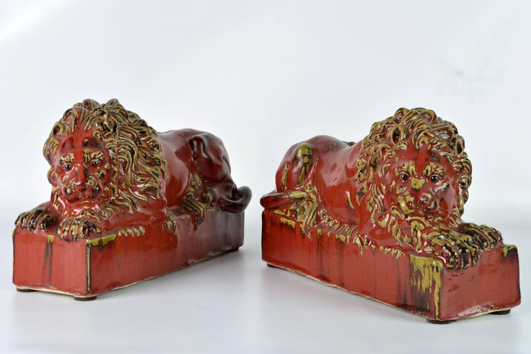 Modern Opposing Pair of 20th Century Oxblood and Celadon Glazed Ceramic Resting Lions For Sale