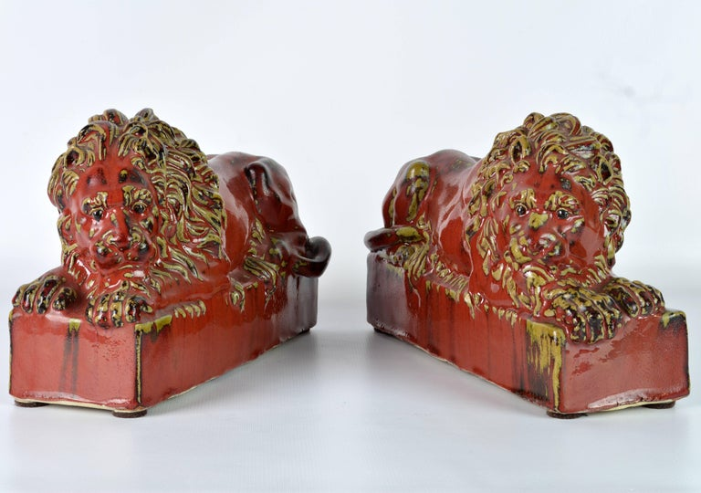 Opposing Pair of 20th Century Oxblood and Celadon Glazed Ceramic Resting Lions For Sale 1