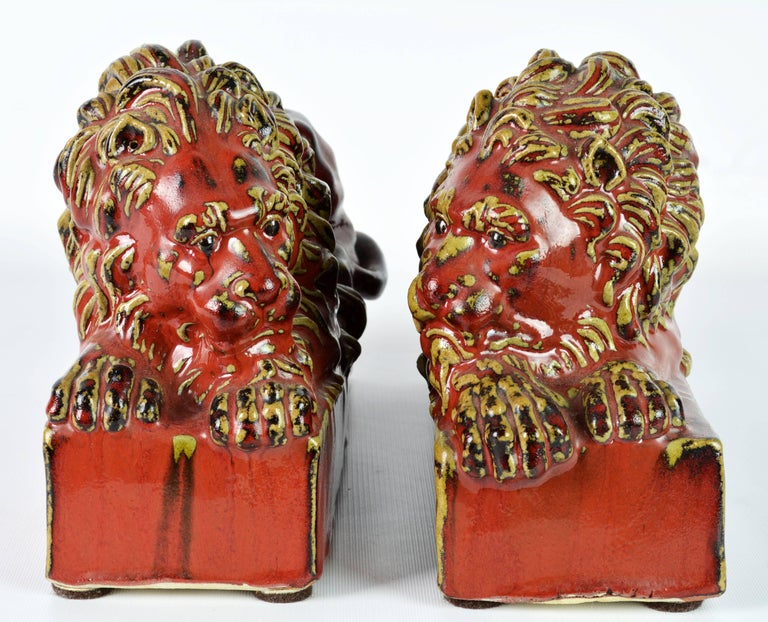 Opposing Pair of 20th Century Oxblood and Celadon Glazed Ceramic Resting Lions For Sale 2