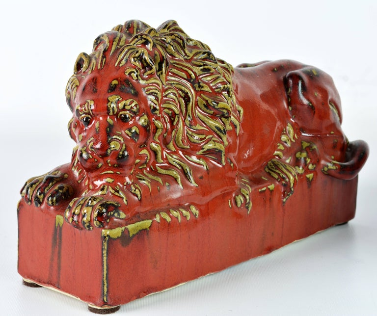 Opposing Pair of 20th Century Oxblood and Celadon Glazed Ceramic Resting Lions For Sale 3
