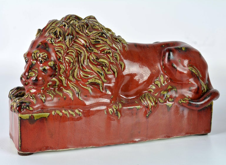 Opposing Pair of 20th Century Oxblood and Celadon Glazed Ceramic Resting Lions For Sale 4
