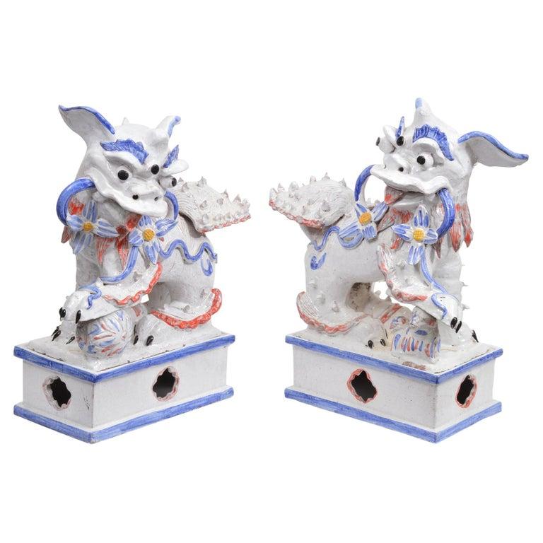 Opposing Pair of Italian Ceramic Glazed Foo Dogs on Bases Manner Ugo Zaccagnini For Sale