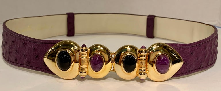 Known for her amazing purses, Judith Leiber's creativity continued with accessories such as this beautiful estate adjustable belt from the 1980s with opulent semi-precious stone-studded, hinged gold-tone metal belt buckle. Adjustable belt is plum or