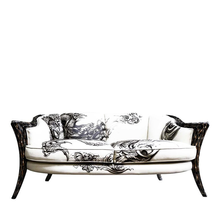 A stunning addition to a modern or eclectic home, this one-of-a-kind two-seat sofa, part of the Opus Futura collection, will make a statement in living room, bedroom or study, infusing a room with unique charm. The wooden frame of the carved legs