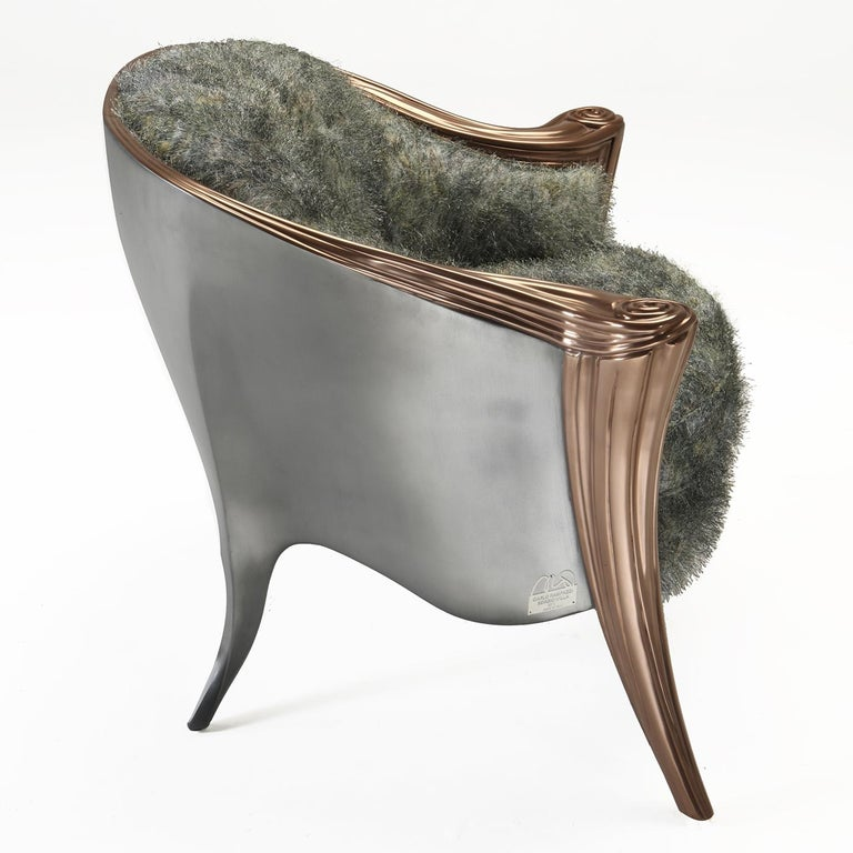 This unique armchair is part of the Opus Metallica collection and is a statement piece that will be eye-catching and unique in an eclectic and contemporary interior. Its sinuous shell in wood is finished with their Real Steel varnish, containing 95%