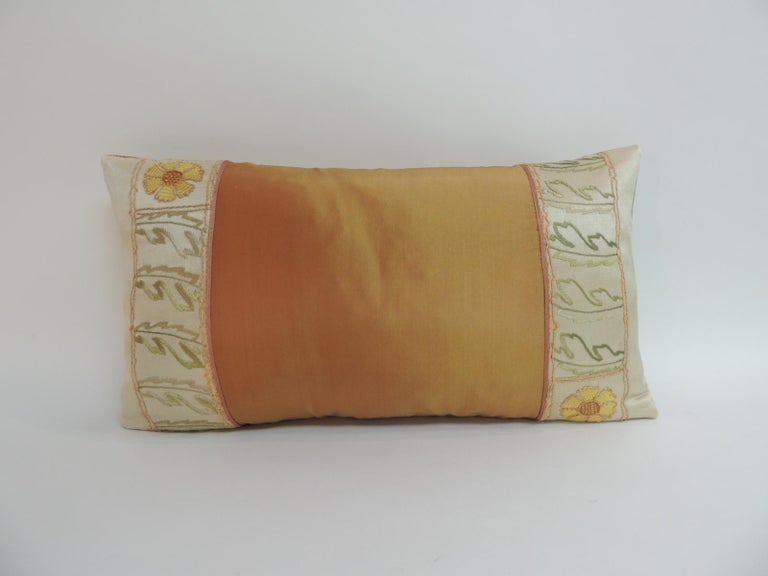 Orange Turkish embroidered silk-on-silk decorative pillow with accents of gold metallic threads in the floral embroidery.  Orange silk inset panel and backing. Throw pillow embellished with a small flat silk decorative trim at the seams.