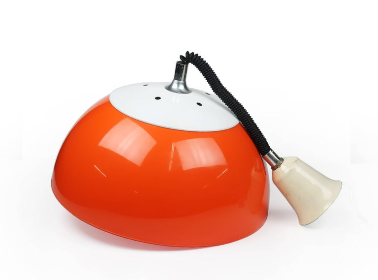 Large 1970s Italian Modern orange retractable pendant lamp in excellent vintage condition. This perfect pop-styled lamp has a chrome handle below the orange plastic shade to pull the light down or push it up to the required height. (Stays in place