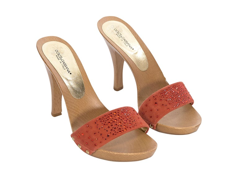 Product details:  Orange suede mule sandals by Dolce & Gabbana.  Embellished with crystals.  Open toe.  Slip-on style.  4
