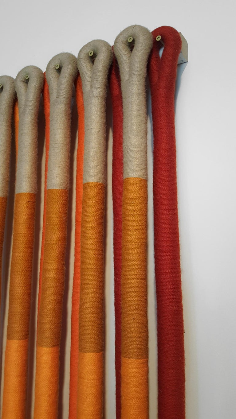 'Orange Gradient' by Fiber artist Jane Knight. Comprised of 19 elements, signed with copper metal label, excellent condition.  Jane Knight (1928-2013) was born in Grosse Pointe and received her BFA from the University of Michigan in 1951. After