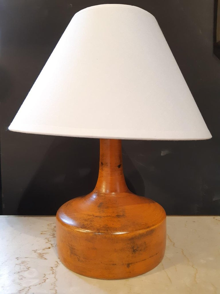 Orange Jacques Blin ceramic lamp France midcentury, 1950   Electricity ok and new lampshade provided.  Signed under the base.  Measures: Socket height 16.5cm. Height with shade 30cm. Diameter 16cm  Excellent condition.