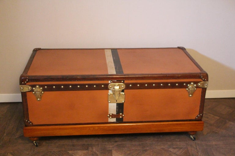 This very nice orange canvas Louis Vuitton steamer trunk, features Louis Vuitton stamped solid brass lock, clasps as well as all its studs. Beautiful and rich honey color leather trim and handles. Unusual and elegant proportions.