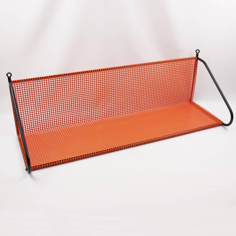 Mid-Century Modern Manner of Mathieu Mategot Orange Perforated Metal Wall Mounted Bookshelf  For Sale