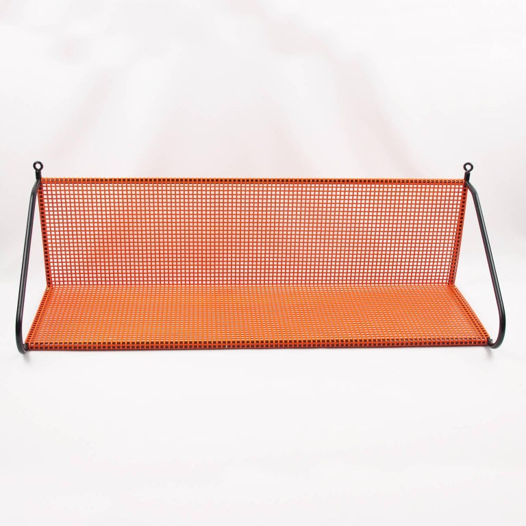 20th Century Manner of Mathieu Mategot Orange Perforated Metal Wall Mounted Bookshelf  For Sale