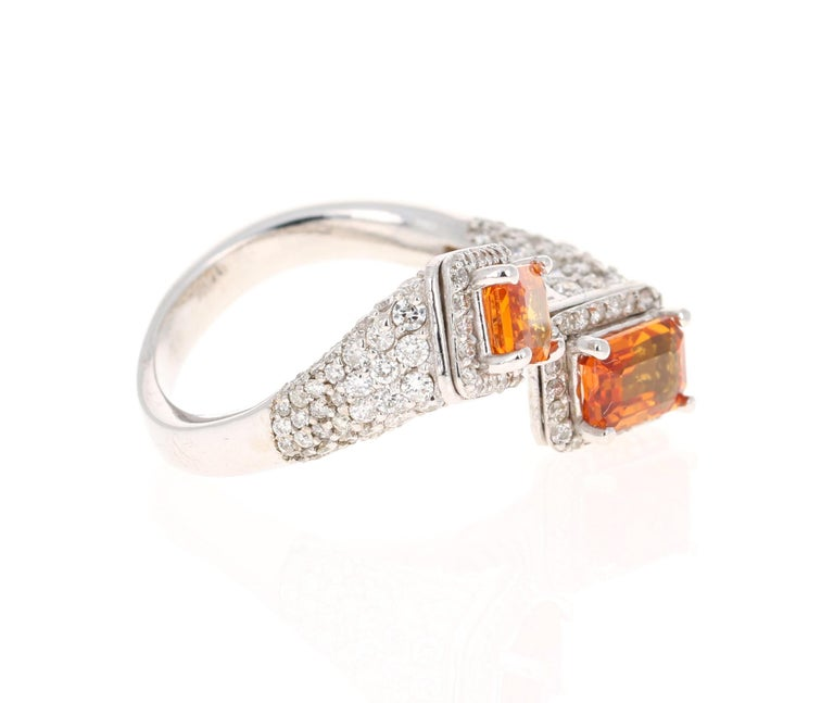 A Unique Orange Sapphire Ring for your collection!  This beautiful ring has 2 Natural Emerald Cut Orange Sapphries that weigh 2.31 carats as well as 169 Round Cut Diamonds that weigh 1.37 carats Carats. The total carat weight of the ring is 3.68