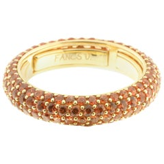 Orange Sapphire Eternity Ring in 18 Karat Yellow Gold