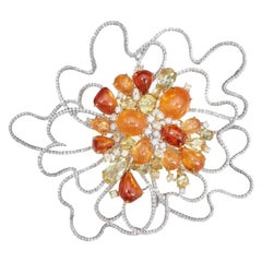 Orange Tourmaline, Hessonite, Garnet, Yellow Sapphire and Diamond Cluster Brooch