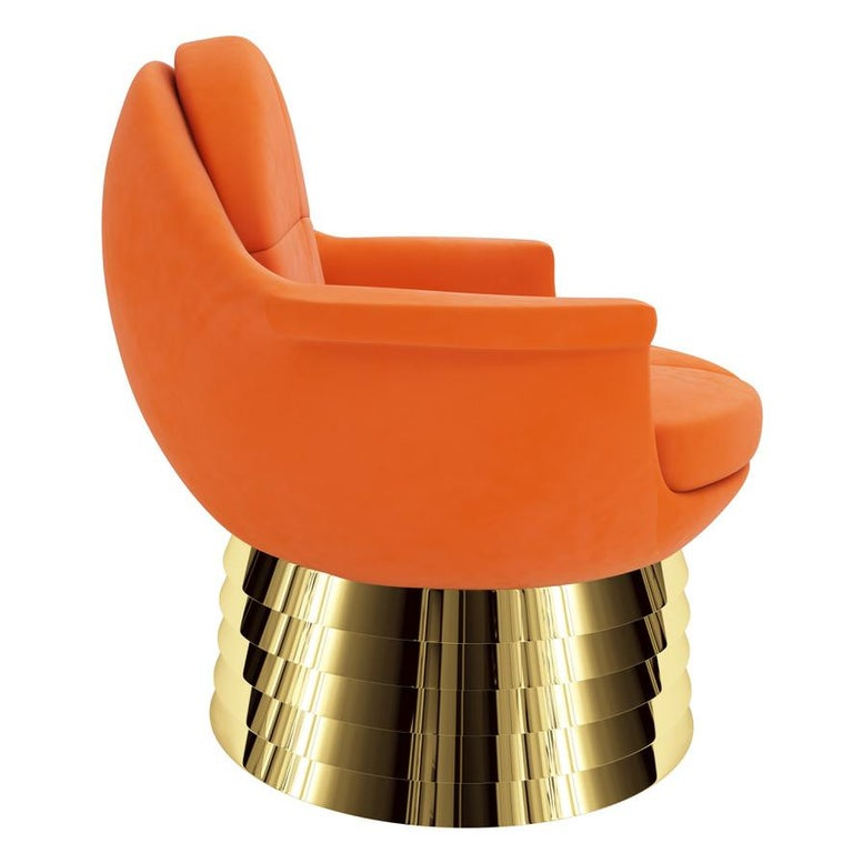 The iris lounge chair was named after the iris of the human eye. When you look at the lounge chair from straight on the wing tip armrests and round shape reflects the symmetry of the eye. The base is made from staggered polished brass and the seat