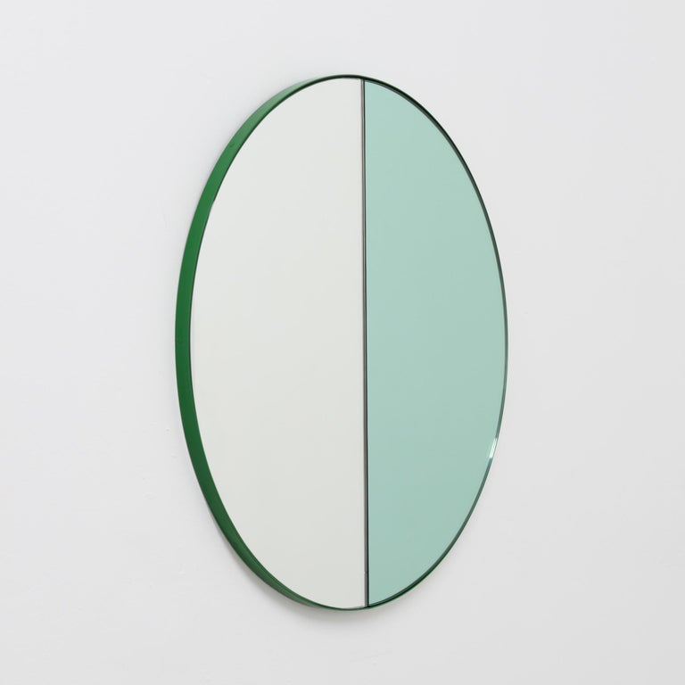 Delightful handcrafted mixed tinted (silver & green) Orbis Dualis mirror with a modern green frame.  Designed and handcrafted in London, UK. The detailing and finish, including visible screws, emphasize the craft and quality feel of the mirror, a