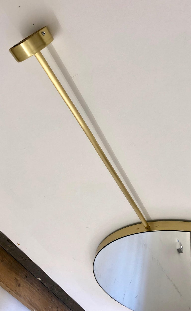 Orbis round double sided suspended bathroom silver mirror with a brass frame.  Contact us for a bespoke size.