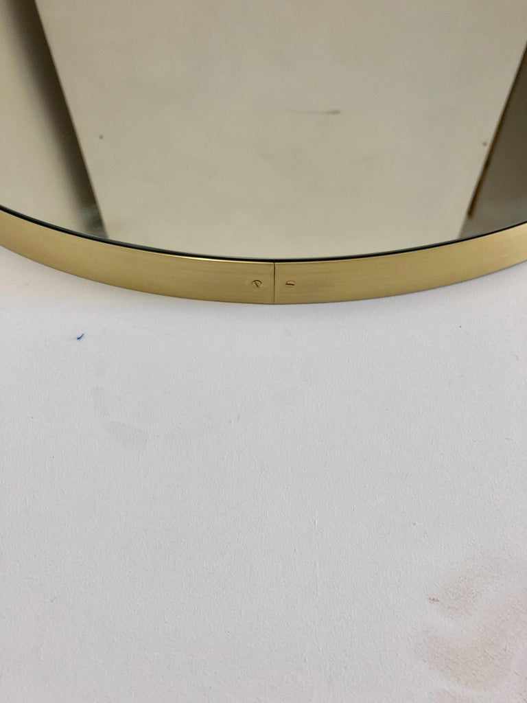 British Orbis Round Double Sided Suspended Bathroom Mirror with a Brass Frame For Sale