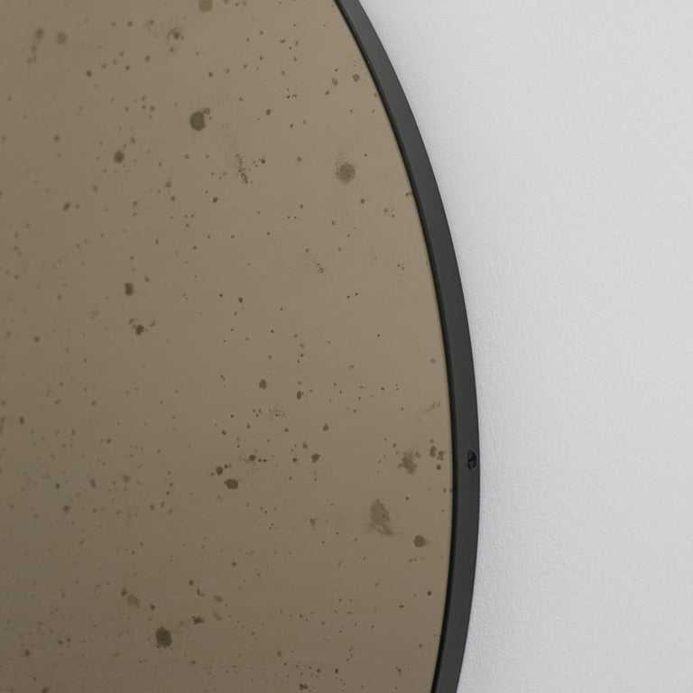 Orbis™ Round Bronze Antiqued Modernist Bespoke Mirror with Black Frame - Medium For Sale 2