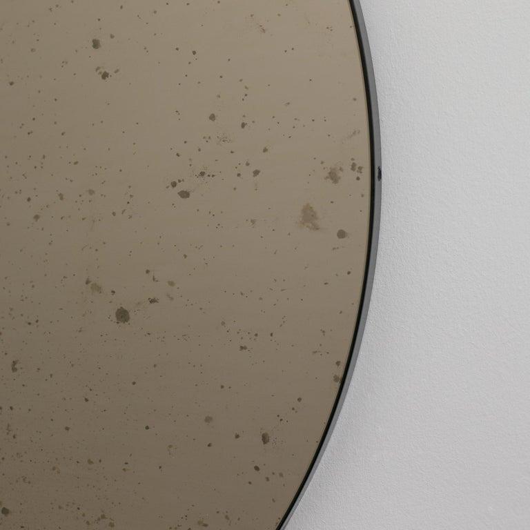 Organic Modern Orbis™ Round Bronze Antiqued Modernist Bespoke Mirror with Black Frame - Medium For Sale