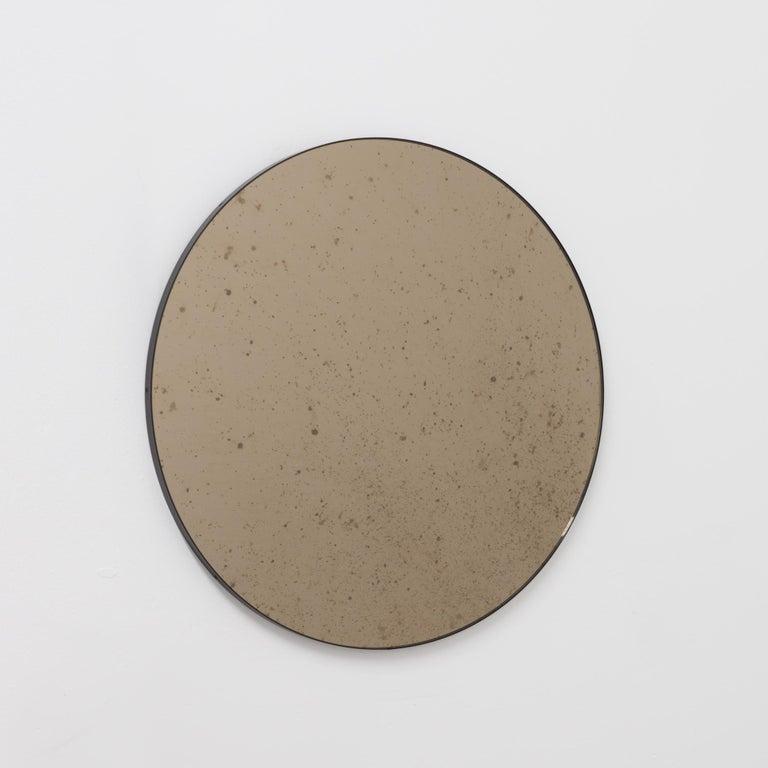 British Orbis™ Round Bronze Antiqued Modernist Bespoke Mirror with Black Frame - Medium For Sale