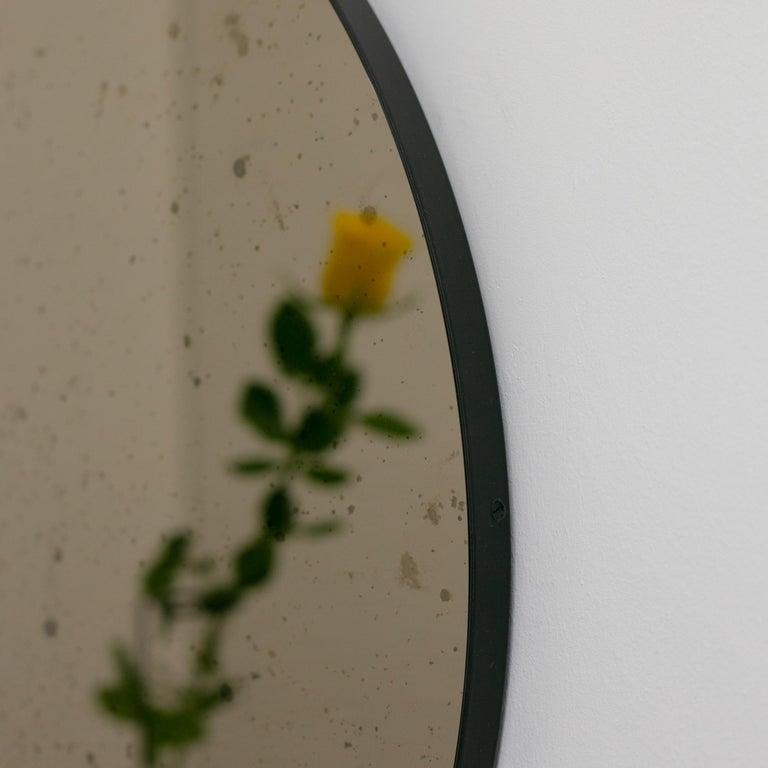 Powder-Coated Orbis™ Round Bronze Antiqued Modernist Bespoke Mirror with Black Frame - Medium For Sale