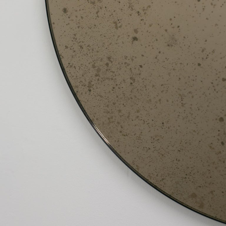 Orbis™ Round Bronze Antiqued Modernist Bespoke Mirror with Black Frame - Medium In New Condition For Sale In London, GB