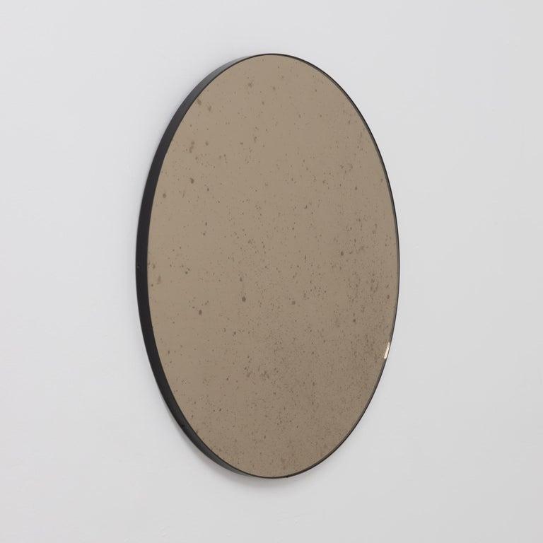Contemporary Orbis™ Round Bronze Antiqued Modernist Bespoke Mirror with Black Frame - Medium For Sale