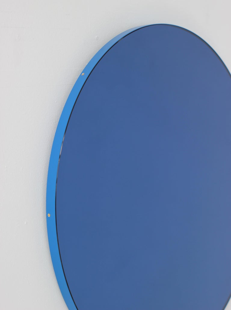 Orbis Circular Mirror with Blue Frame and Blue Tint, Medium Size In New Condition For Sale In London, GB