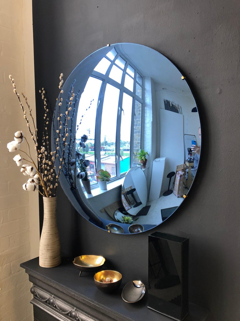 Stunning frameless blue convex mirror for a unique statement above a fireplace, a console table or anywhere in a home, hospitality or commercial space.  Each Orbis convex mirror is handcrafted. Slight variations in dimensions, tint and finish are