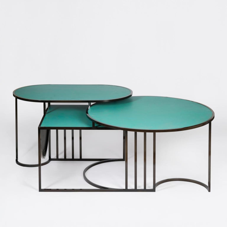 *This table is a sample, it has some scratches and imperfections, please see photos attached.*  The Orbit Coffee table is constructed from three tiered tops: round, oblong and square, each resting at different height level.    Lara Bohinc's new