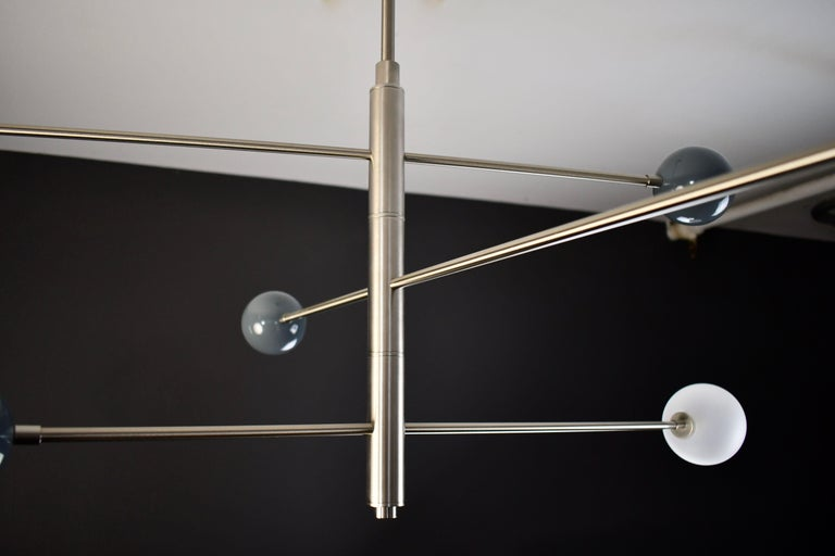 Handcrafted in NYC by Blueprint Lighting, our 'Orbital' Chandelier is a commanding statement piece with design elements of both Italian and French modernism as well as Hollywood Glam and is a stunning study in mixed materials.