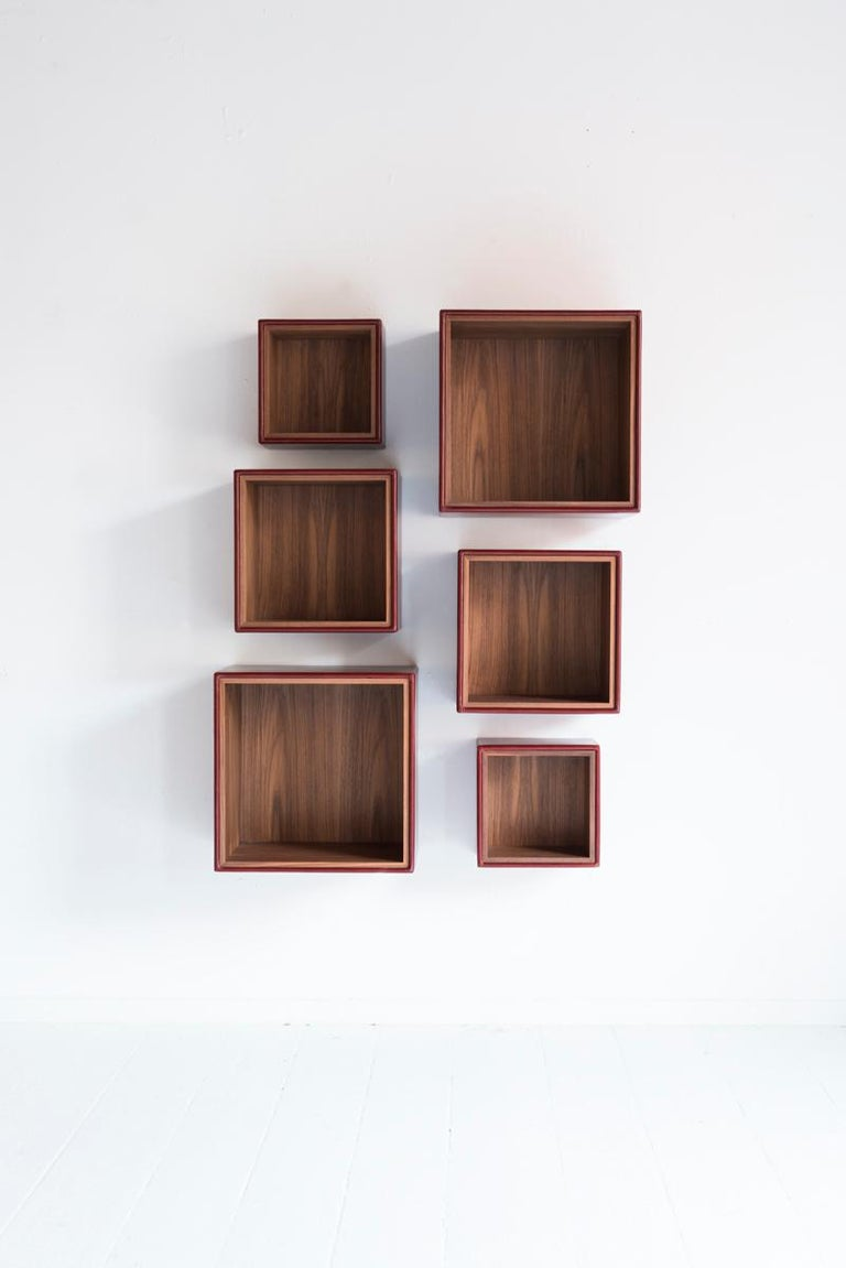 Orchestra is a sectional bookcase but, nevertheless, immune from the formal rigidity of a repetitively geometrical modularity. Made up of three elements in different sizes and depths, Orchestra may evolve freely and organically in its surrounding