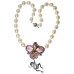 Orchid, Dragonfly and Frog in Diamond and Sapphire on an Australian Pearl Collar