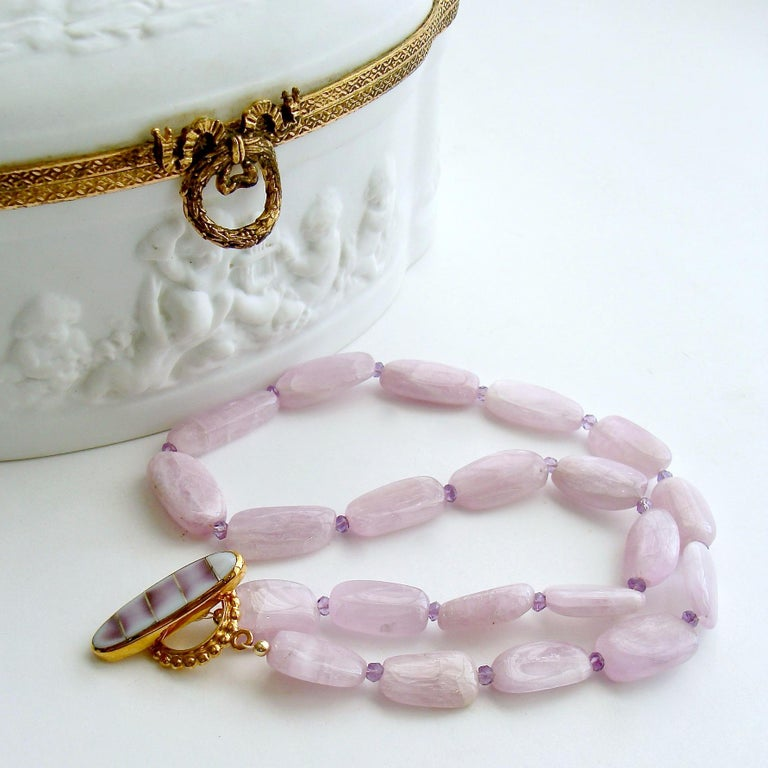 Orianne V Necklace  A stunning suite of smooth flat kunzite nuggets in a sweet orchid confectionery color, create a modern and feminine choker necklace.  The untamed nature of these gorgeous confectionery colored stones is a sophisticated