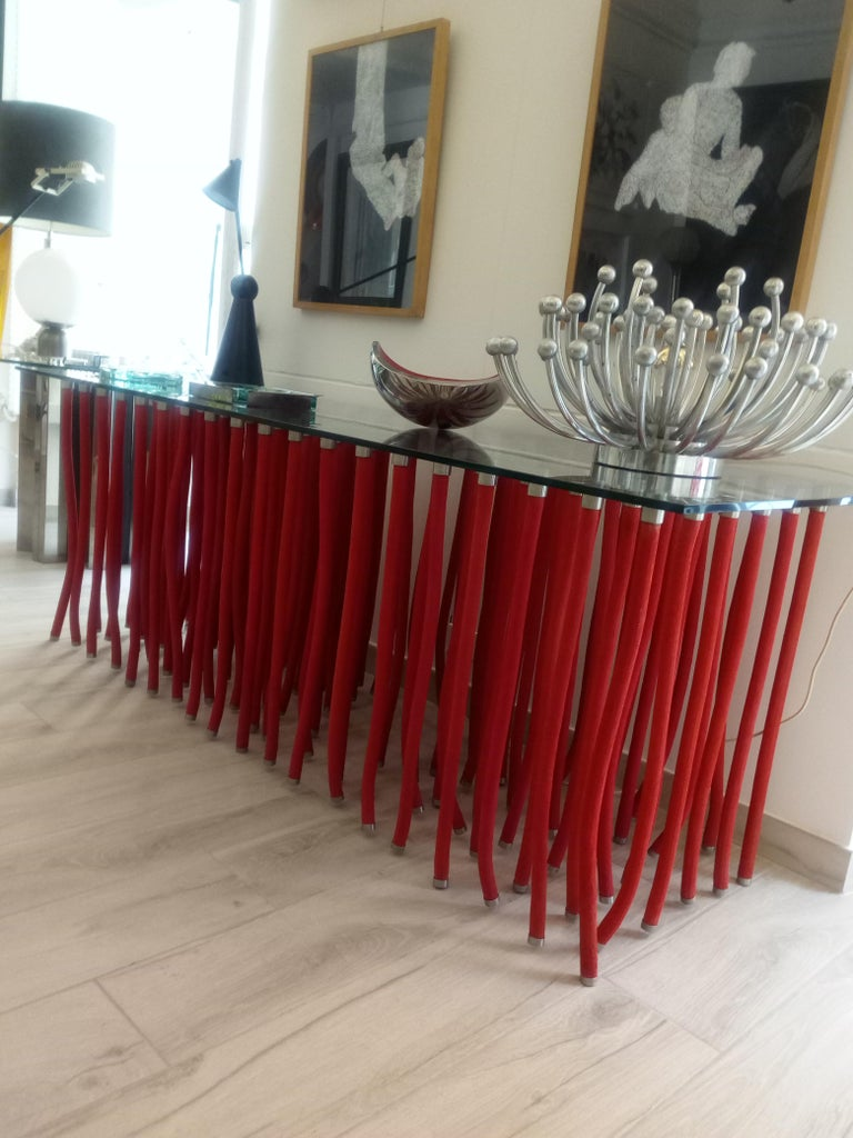 Beautiful ORG table or console designed by Fabio Novembre and manufactured by Cappellini in Milano Italy in 2001 The table is made out of flexible polypropylene with internal steel and satin stainless steel caps both on the top and the bottom,