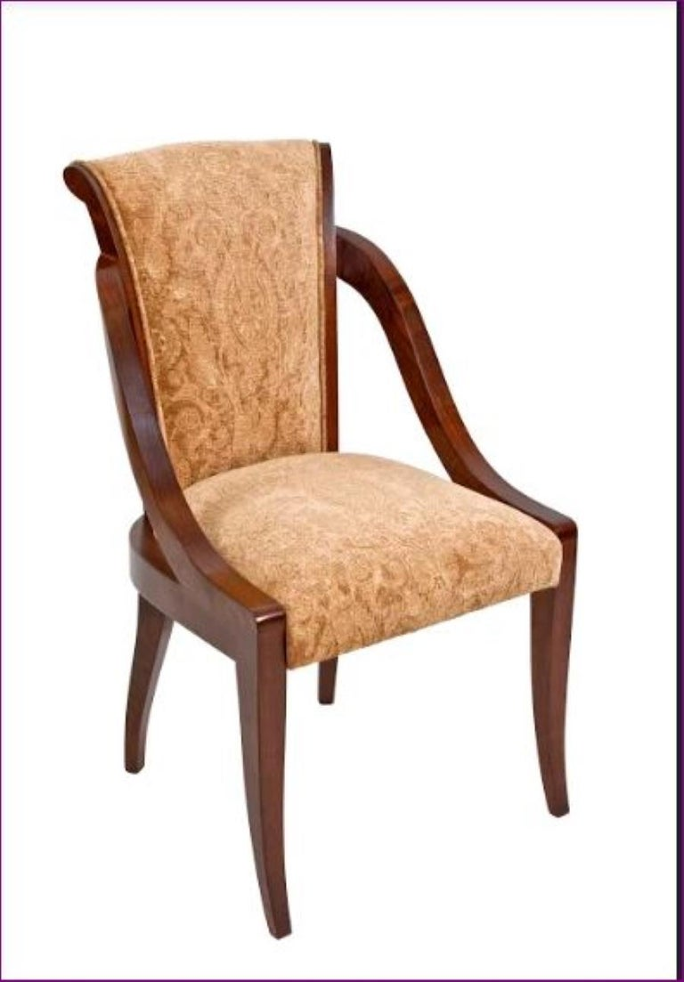 Organic Deco Dining Chair in Solid Walnut, Upholstered in Fabric or Leather  Mortise and tenon solid wood construction with sculpted arm. Very unique one of a kind design. Can be made in any volume you require and upholstered in customers choice of